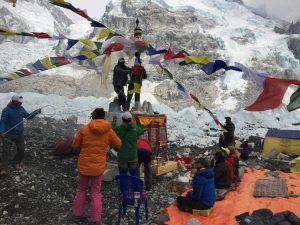 Lifting the ceremonial prayer flags.